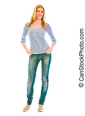 Full length portrait of smiling beautiful teen girl with hands in pockets of jeans  isolated on white