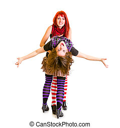 Two jaunty girlfriends funny embracing isolated on white