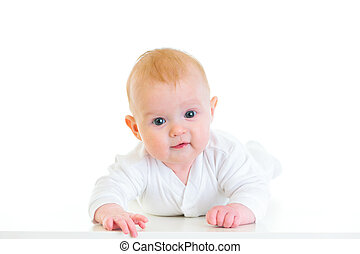 Smiling four month old  baby girl laying on abdomen