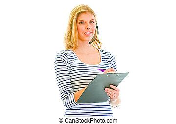 Pretty teen girl in headset writing in clipboard