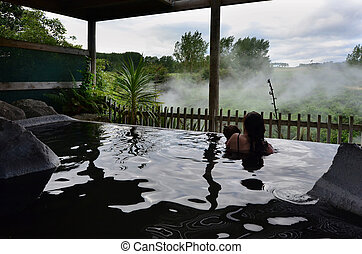 New Zealand Hot Spring and Spa Pool in Rotorua - A woman and...