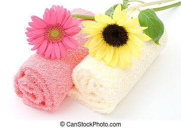 Flower on the towel - Sunflower and gerbera daisy on the...
