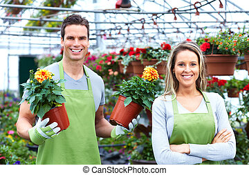 Florists couple working at flower shop - Florists couple...