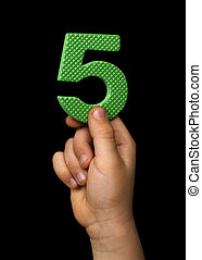 Children hand holding the number Five