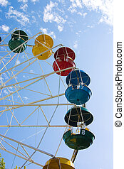 Popular attraction in park - a Ferris wheel on a background...
