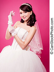 beautiful bride - beautiful happy bride putting on gloves,...