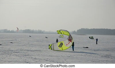 snow kiting on winter lake ice