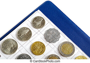 Album with coins for numismatics over white