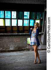 Girl in an old factory