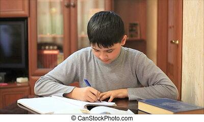 Teen prepares homework