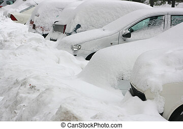 Undercover cars and vehicles on parking after heavy snow...