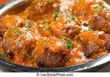 meatballs in tomato sauce on a plateItalian cuisine