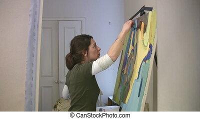 Artist working in the studio.
