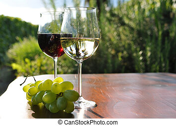 Pair of wineglasses and bunch of grapes. Lavaux region,...