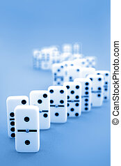 Dominoes standing on blue background