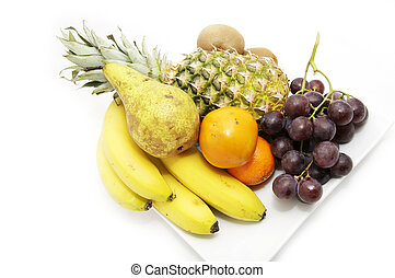 a plate of fruit - plate with whole fruits on a white...