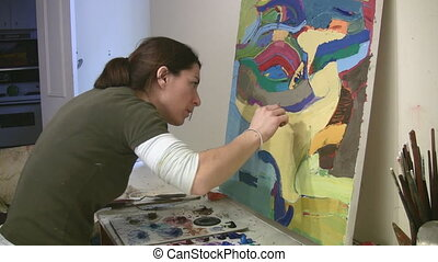 Artist working in the studio.