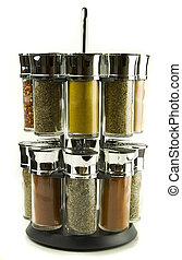 spices - different spices rolling set in glass jars on...