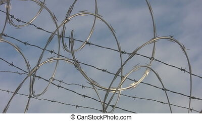 Barbed wire Timelapse - Barbed razor wire Timelapse clouds...