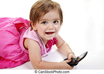 Baby Girl with Cell Phone - Smiling and Cute baby girl in...