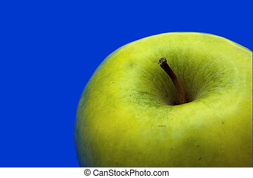 appetizing apple of green color on a blue background