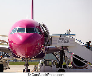 Airplane parked  - Fuchsia Airplane parked  in airport
