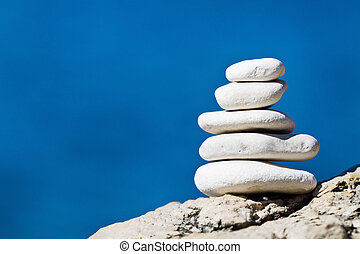 Stone stack balance - Close-up of white pebbles stack over...