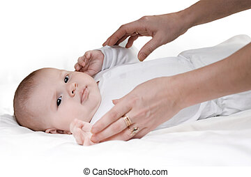 little boy and caring hands of mother on a white background
