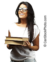 portrait of young girl holding books over white background