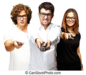 young friends changing channel over white background