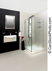 Modern shower - Modern bathroom with black and white tiles