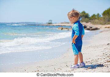 Little cute boy on the beach - Little cute boy on the exotic...