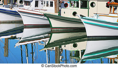 Motorboats reflection in still water. - Motorboats...