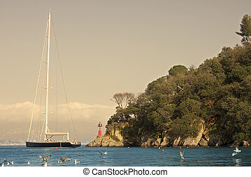 Portofino - Big yacht in Portofino lagoon on Ligurian sea in...