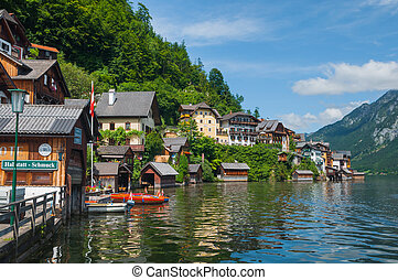 historical street of Hallstatt, village near the lake,...
