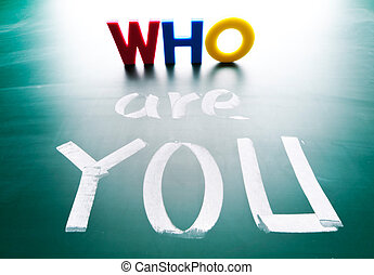 Who are you, concept words on blackboard. - Who are you,...