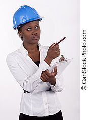 Young South African woman wearing a hard-hat, and making...