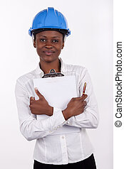 Gorgeous South African woman with a notepad and hard-hat