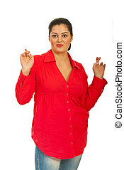 Beauty woman wishing - Beauty woman in red shirt standing...