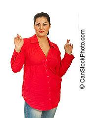 Beauty woman wishing - Beauty woman in red shirt standing...