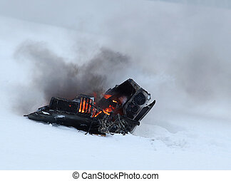 Computer burning in the snow - Old computer burning in the...
