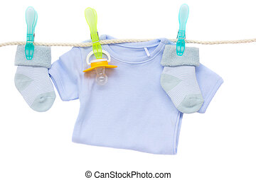 baby blue clothes hanging on rope on white background