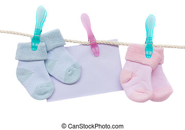 baby blue and pink socks with blank envelope hanging on rope...