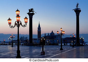 Morning at San Marco square. Saint Theodore and Lion of...
