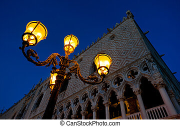 Evening at San Marco square. Doge`s Palace and antique...