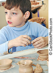 shaping clay kid - kid  shaping clay at pottery studio