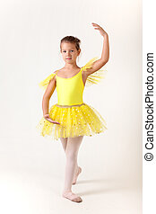 Cute little girl as ballet dancer, studio shot on white...