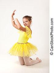 Cute little ballerina exercising