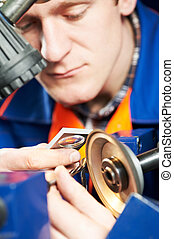 worker measuring detail - mechanical technician worker...