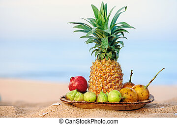 Tropical fruit - Exotic tropical fruit on the leaves plate...